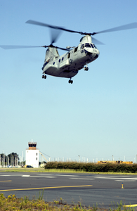 A Ch-46 Sea Knight Assigned To The Dragon Whales Of Helicopter Combat Support Squadron Eight (hc-8), Evacuate Aircraft Inland. Image