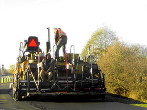 Road Repair Crew On South Dyke Road Crop Image