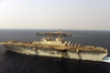 The Amphibious Assault Ship Uss Iwo Jima (lhd 7) And Uss Nimitz (cvn 68) Participate In Air Operations In The Arabian Gulf Image