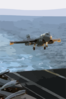 An Ea-6b Prowler Assigned To The Patriots Of Electronic Attack Squadron One Four Zero (vaq-140) Approaches The Flight Deck Of Uss George Washington (cvn 73) During Evening Flight Operations. Clip Art