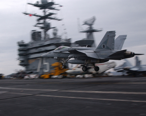 An F/a 18  Hornet   Assigned To The  Gunslingers  Of Strike Fighter Squadron One Zero Five (vfa-105), Performs A  Touch And Go  On The Ship S Flight Deck. Image