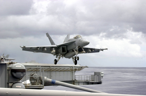 An F/a-18e Super Hornet From The Tophatters Of Strike Fighter Squadron Fourteen (vfa-14) Takes Off From One Of Four Steam Powered Catapults On The Flight Deck Of Uss Nimitz (cvn 68) Image