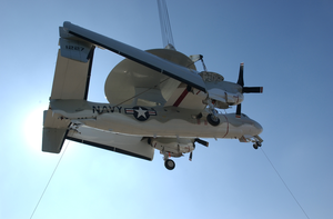 A Retired E-2 Hawkeye Is Hoisted Aboard The Decomissioned Aircraft Carrier Midway At Naval Air Station North Island. Image