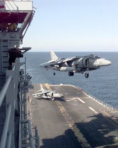 The Air Boss Watches As The Last Av-8b  Harrier  From Helicopter Medium Squadron Two Six Six  (hmm-266) Lands On Board Uss Nassau  Following A Strike Mission Into Kosovo. Image