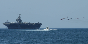 An Acrobatic Group Of Spain Aircraft Perform Aerial Maneuvers Over Uss Theodore Roosevelt (cvn 71), Anchored Off The Coast Of Cartagena, Spain Image