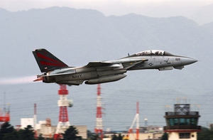 An F-14 Tomcat Assigned To The  Black Knights  Of Fighter Squadron One Five Four (vf-154) Departs Naval Air Facility Atsugi, Japan. Image