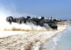 Landing Craft Air Cushion Eighty Four (lcac-84) Departs The Beach With Supplies, Ammunition, And Vehicles Image