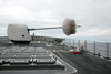 A 54 Caliber Mk-45 Five-inch Gun Fires A Projectile Off The Ship S Starboard Side Image