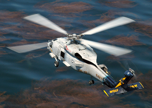 A Sh-60 Seahawk Passes By Naval Air Station North Island During A Routine Training Flight Image