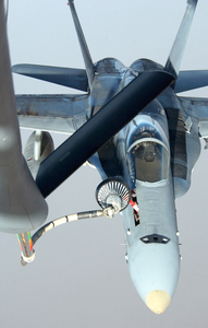 A U.s. Navy F/a-18 Hornet Takes Fuel From An Air Force Kc-135 Stratotanker In The Skies Near Iraq. Image