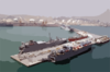 Military Sealift Command (msc) Ships Sit Tied Up To The Pier In The Port Of Ash-shu Clip Art