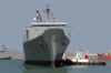 Tugboats Ease The Military Sealift Command (msc) Fast Sealift Ship Usns Bellatrix (t-akr 288) Into The Port Of Mina Ash-shu Clip Art