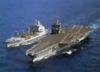 The Uss Enterprise (cvn 65) Steams Alongside The Military Sealift Command Fast Combat Support Ship Usns Leroy Grumman (aoe 195) During An Underway Replenishment (unrep) Clip Art