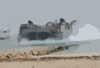 A Landing Craft, Air Cushion (lcac) Assigned To Assault Craft Unit Five (acu-5) Transports Equipment. Clip Art