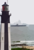 Precommissioning Unit (pcu) Ronald Reagan (cvn 76) Passes A Lighthouse Located At Fort Story Army Base Clip Art