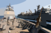 The Fast Combat Support Ship Uss Bridge (aoe 10) Transfers Fuel To The Guided Missile Cruiser Uss Chosin (cg 65) During An Underway Replenishment Clip Art