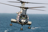 An Ch-46 Sea Knight Helicopter Assigned To Helicopter Combat Support Squadron Eleven (hc 11) Prepares To Pick Up Sling Loaded Cargo From The Fast Combat Support Ship Uss Camden (aoe 2). Image