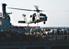 An Mh-60s Knighthawk Assigned To The  Chargers  Of Helicopter Combat Support Squadron Six (hc-6), Receives A Palette Of Supplies Aboard The Military Sealift Command (msc) Fast Combat Support Ship Usns Supply (t-aoe 6). Image
