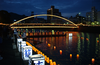 Illuminated By The Albuquerque Bridge, Japanese Volunteers Place Candlelit Lanterns Into The Sasebo River During The City S Annual Obon Festival Image