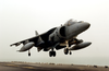 A Marine Av-8b Harrier Makes A Vertical Landing Aboard The Amphibious Assault Ship Uss Bonhomme Richard (lhd 6). Image