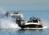 Landing Craft Air Cushion (lcac) Craft Approach The Amphibious Assault Ship Uss Kearsarge (lhd 3) Image