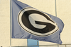Waving Flag With Letter G On It Image