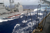 The Guided Missile Cruiser Uss Antietam (cg 54) Prepares To Receive A Fuel Hose From The Fast Combat Support Ship Uss Sacramento (aoe 1) During A Replenishment At Sea (ras) Image