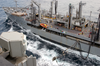 Usns Rappahannock (t-ao 204) Guides Over Hoses To Transfer Fuel To Kitty Hawk During A Replenishment At Sea (ras). Image