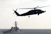 Sh-60f Seahawk Patrols The Waters Astern Of The Guided Missile Destroyer Uss Arleigh Burke (ddg 51) Image