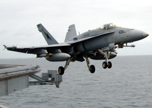 An F-18c Hornet Launches From Uss Abraham Lincoln. Image