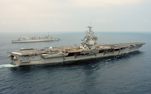 The Nuclear Powered Aircraft Carrier Uss Enterprise (cvn 65) Completes An Extensive Weapons On-load With The Fast Combat Support Ship Uss Detroit (aoe 4). Image