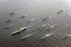 The Kitty Hawk Battle Group Align Themselves To Participate In A Photo Exercise Image
