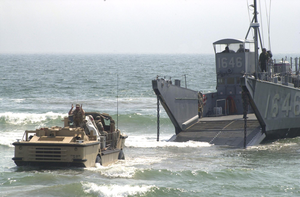 A Lighter Amphibious Re-supply Cargo (larc) Vehicle Drives Into The Waves Image