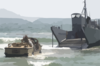 A Lighter Amphibious Re-supply Cargo (larc) Vehicle Drives Into The Waves Clip Art