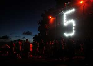 Day Light Runs Out On A Steel Beach Picnic Held Aboard The Uss Peleliu (lha 5) Image