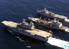 The Military Sealift Command Supply Ship Usns Patuxent (t-ao-201) Conducts A Dual Underway Replenishment (unrep) Image