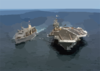 The Nuclear Powered Aircraft Carrier Uss John C. Stennis (cvn 74) Performs An Underway Replenishment (unrep) With The Fast Combat Support Ship Uss Sacramento (aoe 1). Clip Art