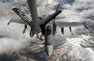 Over The Middle East, An F/a-18 Hornet Assigned To The Uss Harry S. Truman, Conducts Refueling Operations With A U.s. Air Force Kc-135r Stratotanker, Assigned To The 196th Expeditionary Air Refueling Squadron Image