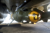 A 500 Pound Laser Guided Bomb Unit (gbu-12) Is Mounted On An F-14d Tomcat Image