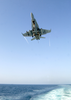 F/a-18 Hornet Makes Arrested Landing Aboard A Carrier At Sea. Image