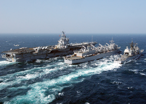The Nuclear Powered Aircraft Carrier Uss Enterprise (cvn 65), Fast Combat Support Ship Uss Detroit (aoe 4), And The Guided Missile Cruiser Uss Gettysburg (cg 64) Perform A Replenishment At Sea. Image