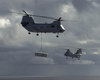 Two Ch-46 Sea Knight Helicopters Transfer Ordnance Image