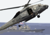 An Sh-60 Seahawk Helicopter Slows Down To Lower It Clip Art