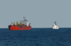 The U.s. Coast Guard High Endurance Cutter Boutwell (whec 719) Moves Into Position Along-side A Cargo Ship To Deploy A Visit, Board, Search And Seizure (vbss) Team. Clip Art
