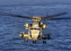 A Ch-53e Flies Over The Atlantic Ocean At Sunrise During Deck Landing Qualification Clip Art