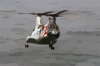 A Ch-46 Sea Knight Helicopter Conducts A Replenishment At Sea (ras) With Uss Kitty Hawk (cv 63). Clip Art