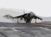 An Av-8b Harrier Jump Jet Assigned To The  Tigers  Of Marine Attack Squadron Five Four Two (vma-542) Prepares To Takes Off From The Flight Deck Of The Amphibious Assault Ship Uss Bataan (lhd 5). Clip Art