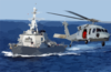 An Mh-60s Knighthawk Helicopter Flies By The Guided Missile Destroyer Uss John S. Mccain (ddg 56) Clip Art