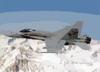 An F/a-18c Hornet Flies Over The Sierra Nevada Mountains During A Routine Training Flight Clip Art