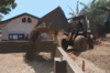 A Front Loader Assigned To The  Club And Spades  Of Naval Mobile Construction Battalion Two Five (nmcb 25), Pours Earth To Be Used In The Building Of A Foundation At The Manuel Memorial Elementary School. Clip Art